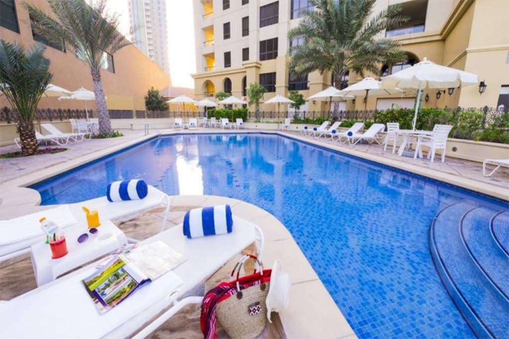 Roda Amwaj Suites Dubai outdoor swimming pool