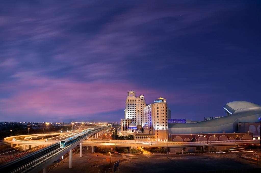kempinski hotel dubai Exterior Night view with Dubai Metro