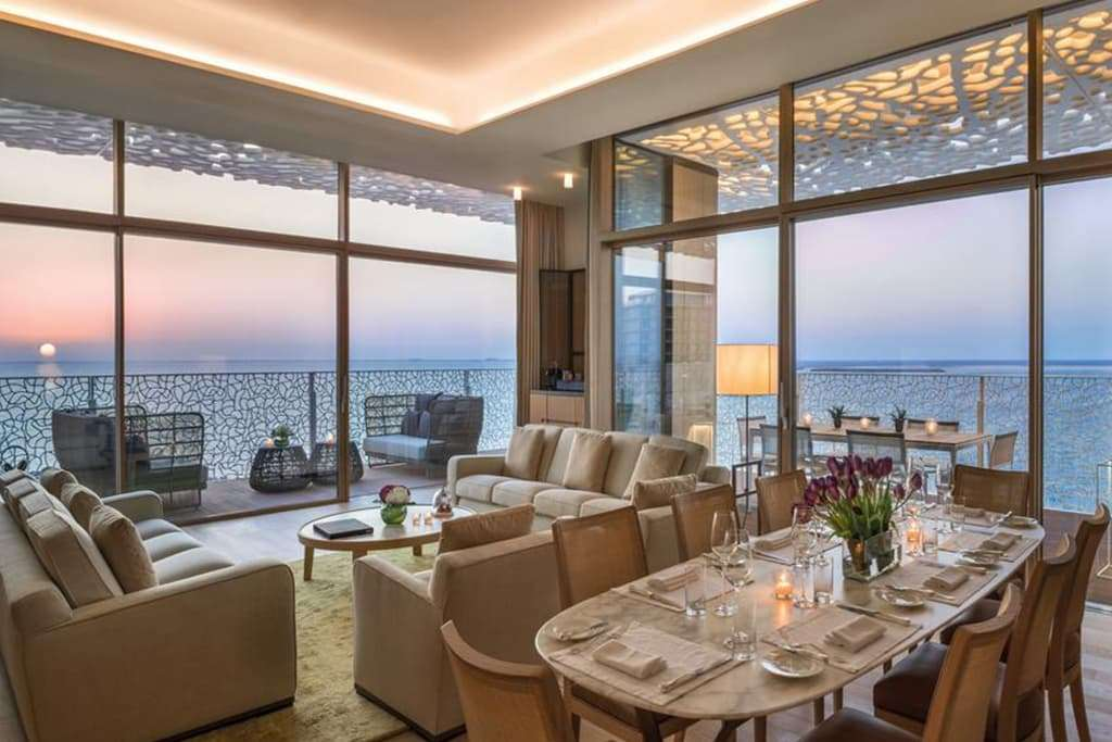 the bulgari suite living room with balcony and sea view